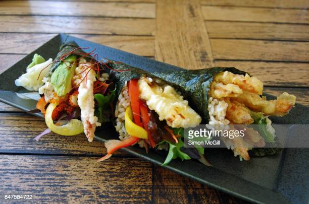 Temaki susuhi rolls including fried halloumi cheese and prawn tempura and vegetables