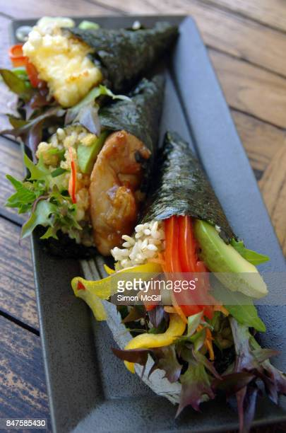 Temaki susuhi rolls including fried halloumi cheese tempura, vegetables, and chicken teriyaki