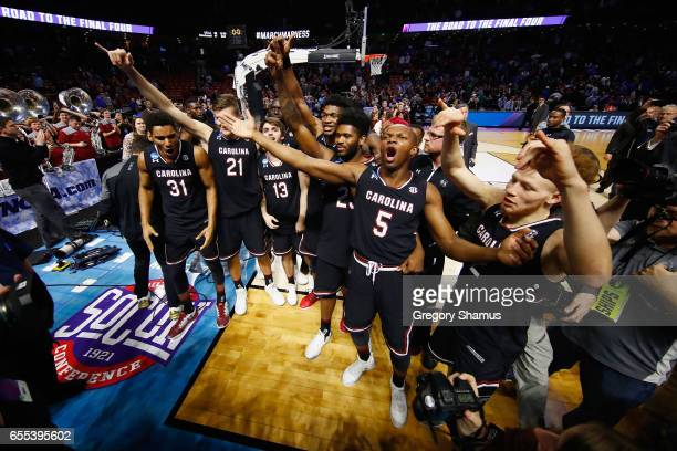 TeMarcus Blanton of the South Carolina Gamecocks celebrates with teammates after defeating the Duke Blue Devils 8881 in the second round of the 2017...