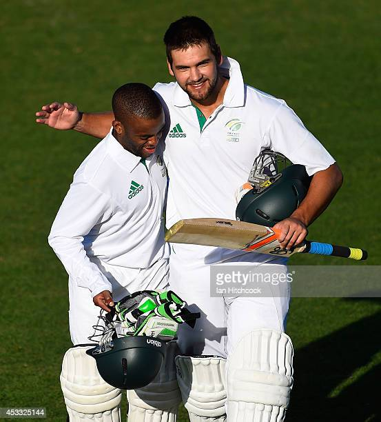 Temba Bavuma and Rilee Rossouw of South Africa 'A' embrace at the close of play during the match between Australia 'A' and South Africa 'A' at Tony...
