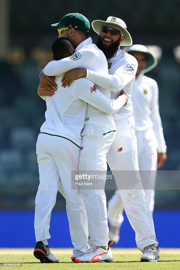 Temba Bavuma, Faf du Plessis and Hashim Amla celebrate after dismissing Josh Hazlewood of Australia during day five of the First Test match between Australia and South Africa at the WACA on November 7, 2016 in Perth, Australia.