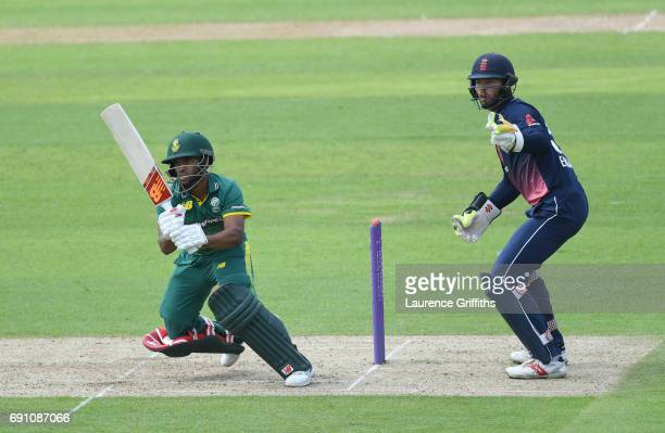 Temba Bavuma of South Africa A his out in front of Ben Foakes of England Lions during the One Day International match between England Lions and...