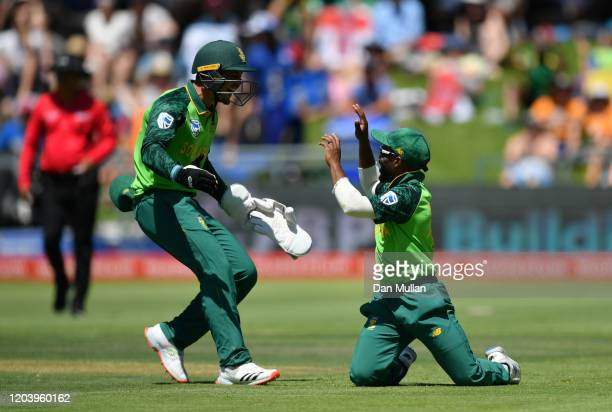 Temba Bavuma of South Africa celebrates with Quinton de Kock after taking the catch of Eoin Morgan of England during the First One Day International...