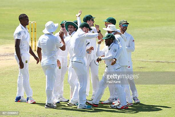 Temba Bavuma of South Africa is congratulated by team mates after running out David Warner of Australia during day four of the First Test match...