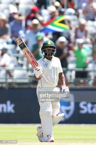Temba Bavuma of South Africa raises his bat after reaching his fifty during day 2 of the 2nd Castle Lager Test match between South Africa and...