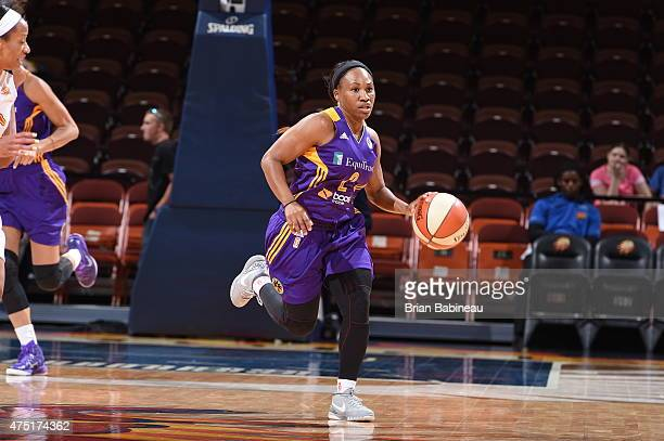 Temeka Johnson of the Los Angeles Sparks brings the ball up court against the Connecticut Sun on May 28 2015 at Mohegan Sun Arena in Uncasville...