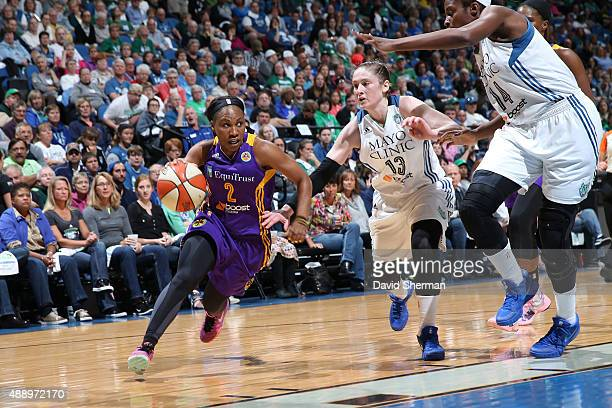 Temeka Johnson of the Los Angeles Sparks drives to the basket against Lindsay Whalen of the Minnesota Lynx during Game 1 of the 2015 WNBA Western...