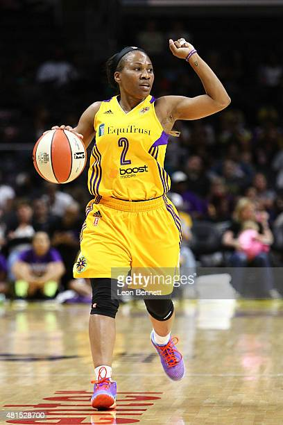 Temeka Johnson of the Los Angeles Sparks handles the ball against the Phoenix Mercury in a WNBA game at Staples Center on July 21 2015 in Los Angeles...