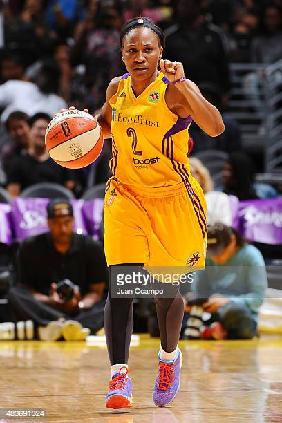 Temeka Johnson of the Los Angeles Sparks handles the ball against the Seattle Storm on August 11 2015 at STAPLES Center in Los Angeles California...