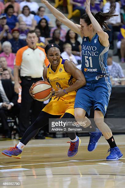 Temeka Johnson of the Los Angeles Sparks handles the basketball against Anna Cruz of the Minnesota Lynx during Game Two of the WNBA Western...