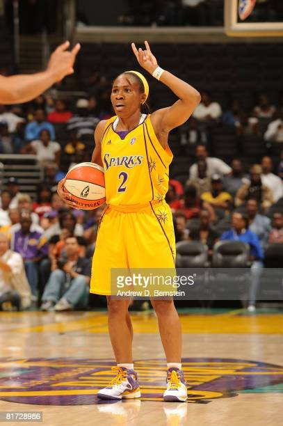 Temeka Johnson of the Los Angeles Sparks motions a play during the game against the Washington Mystics on June 26 2008 at Staples Center in Los...