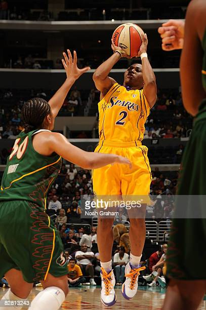 Temeka Johnson of the Los Angeles Sparks shoots over Tanisha Wright of the Seattle Storm on September 14, 2008 at Staples Center in Los Angeles,...