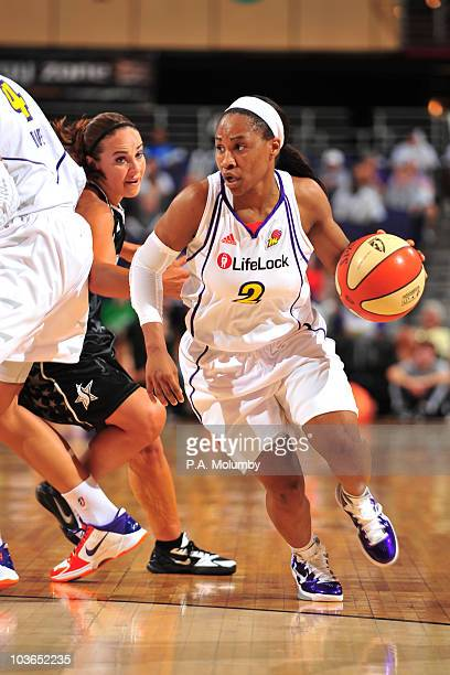 Temeka Johnson of the Phoenix Mercury drives against Becky Hammon of the San Antonio Silver Stars during Game One of the 2010 WNBA Western Conference...