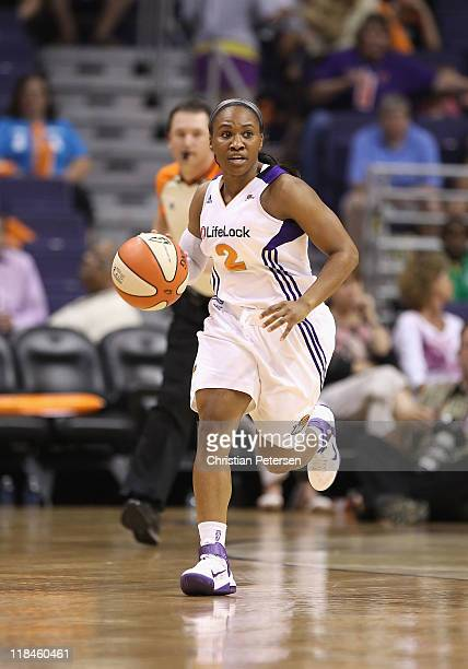 Temeka Johnson of the Phoenix Mercury handles the ball during the WNBA game against the Los Angeles Sparks at US Airways Center on July 5 2011 in...