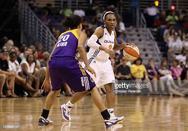Temeka Johnson of the Phoenix Mercury handles the ball during the WNBA game against the Los Angeles Sparks at US Airways Center on September 3 2011...