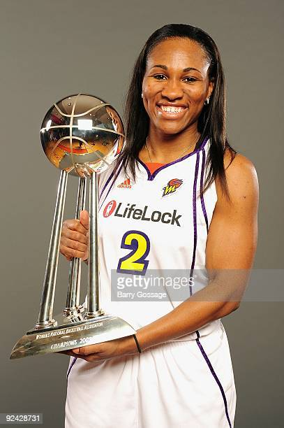 Temeka Johnson of the Phoenix Mercury poses with the WNBA Championship Trophy during the rally at US Airways Center on October 12 2009 in Phoenix...