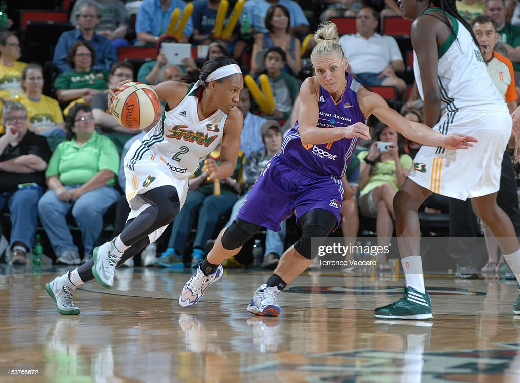 Temeka Johnson #2 of the Seattle Storm handles the ball against Erin Phillips #31 of the Phoenix Mercury during the game on August 17, 2014 at Key Arena in Seattle, Washington.