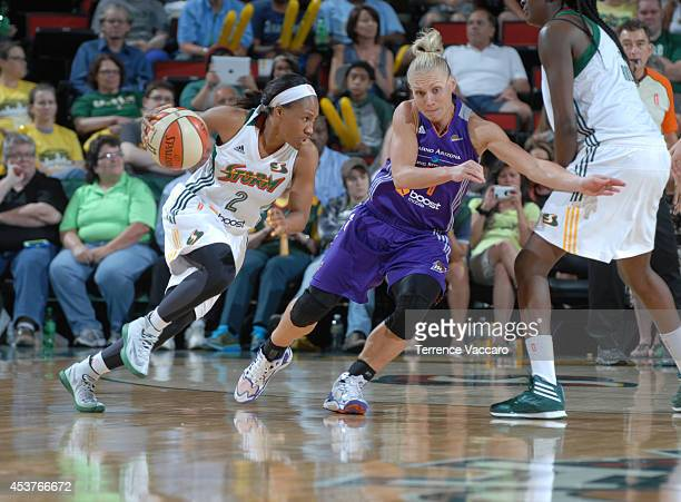 Temeka Johnson of the Seattle Storm handles the ball against Erin Phillips of the Phoenix Mercury during the game on August 17 2014 at Key Arena in...