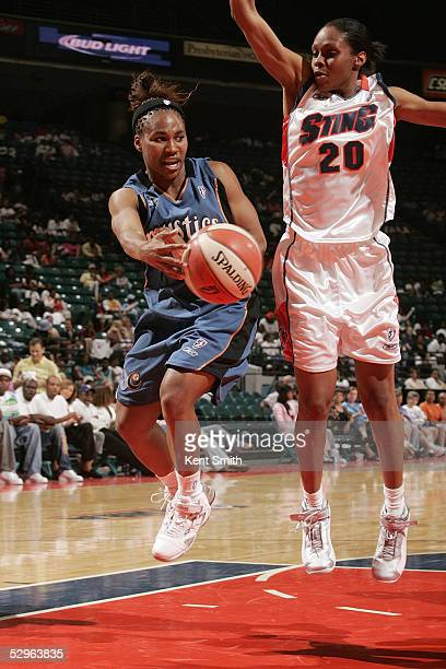 Temeka Johnson of the Washington Mystics drops the assist off while being guarded by Tynesha Lewis of the Charlotte Sting on May 21 2005 at the...