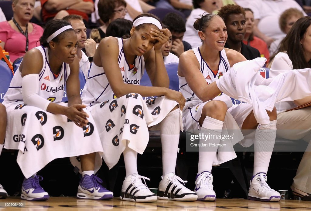 Temeka Johnson #2, Tangela Smith #50 and Diana Taurasi #3 of the Phoenix Mercury react on the bench during the WNBA game against the Seattle Storm at US Airways Center on July 14, 2010 in Phoenix, Arizona. The Storm defeated the Mercury 111-107 in triple overtime.