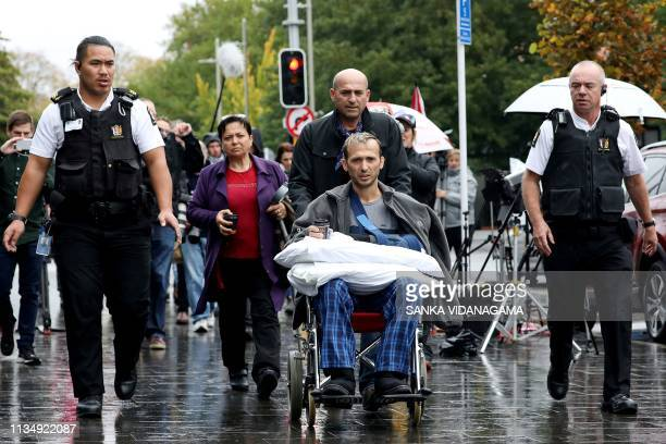 TOPSHOT Temel Atacocugu a survivor of the March 15 twin mosque massacre leaves the Christchurch District Court on April 5 2019 after alleged gunman...
