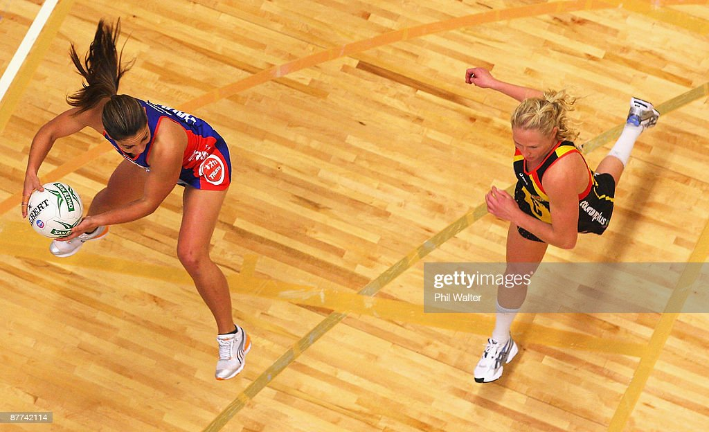 Temepara George of the Mystics (L) takes a pass under pressure from Laura Langman of the Magic (R) during the round seven ANZ Championship match between the Magic and the Mystics played at the Energy Events Centre on May 18, 2009 in Rotorua, New Zealand.