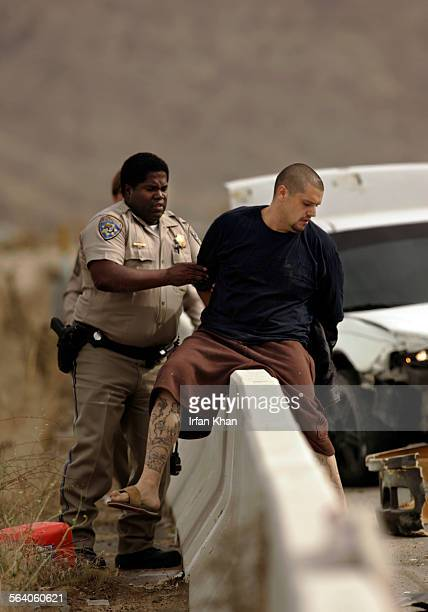 Temescal Valley November 08 2005 – – – California Highway Patrol officer Harvey Ray apprehends a suspect at the end of a two–county high–speed...