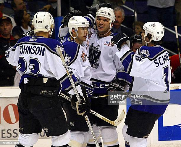 Temmates congratulate Kings right winger Ziggy Palffy who scored late in the first period of Monday night's game against Chicago