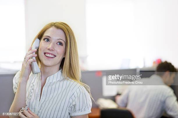 Temp worker answering telephone in office