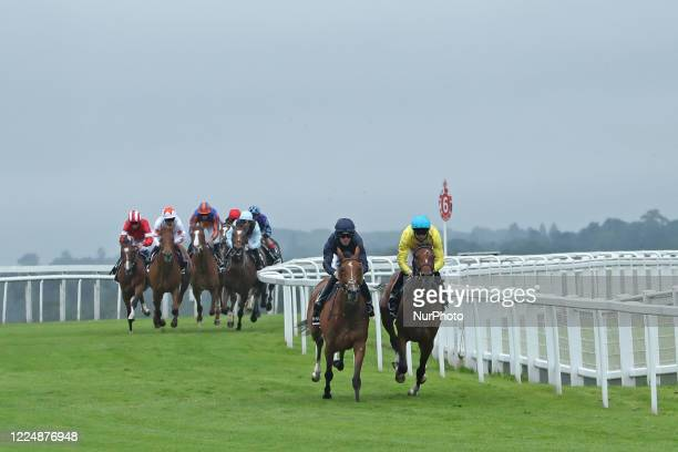 Tempa Vuela with M Harley and Passion with jockey PB Beggy lead the Invested Oaks on Epsom Downs south of London on July 4 2020 which was postponed...