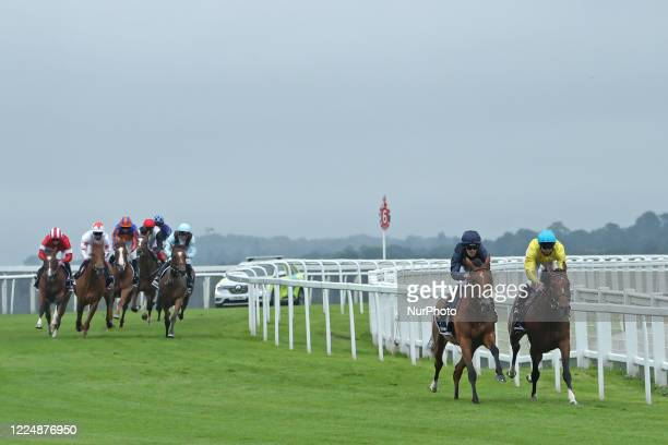 Tempa Vuela with M Harley and Passion with jockey PB Beggy rlead the race in the Invested Oaks on Epsom Downs south of London on July 4 2020 which...