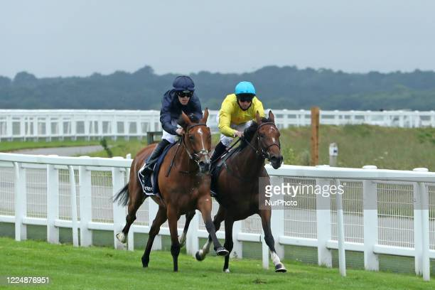 Tempa Vuela with M Harley battle against Passion with jockey PB Beggy race in the Invested Oaks on Epsom Downs, south of London on July 4, 2020 which...