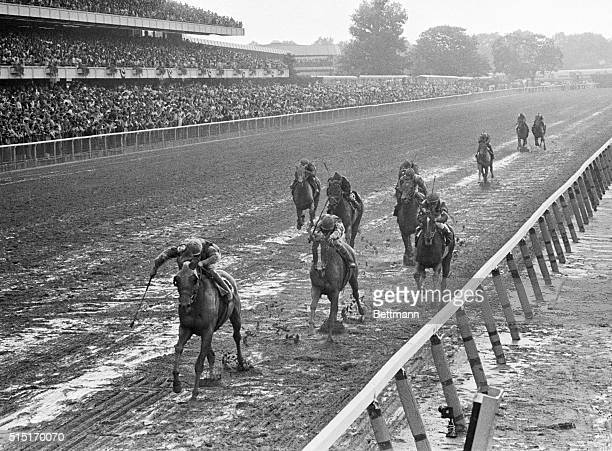 Temperance Hill leads the pack at the Belmont Stakes as the horses approach the finish line Temperance Hill took its first Belmont victory with...