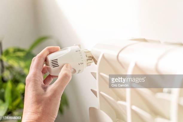temperature control on radiator - cris cantón photography fotografías e imágenes de stock