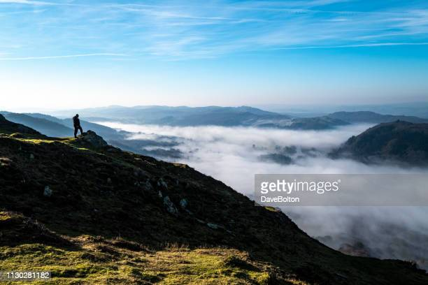 temperature inversion over windermere - lake windermere stock pictures, royalty-free photos & images