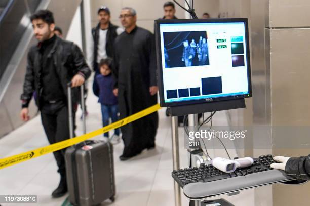 Temperature scanners are used to screen passengers for fever with upon their arrival at Kuwait international airport in Kuwait City on January 29...
