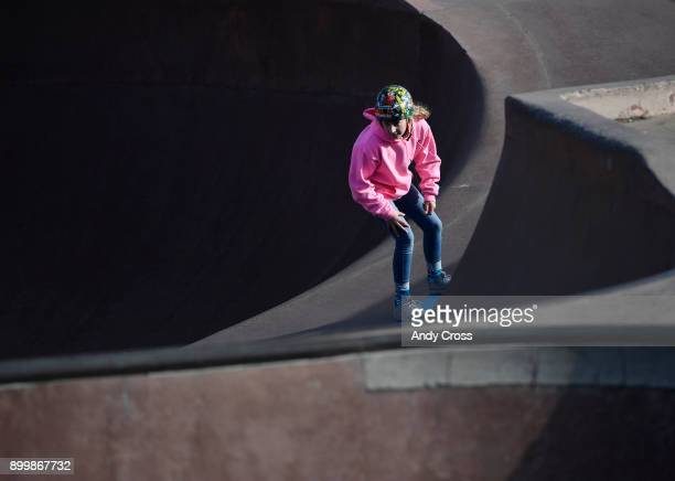 Temperatures in the low 20's didn't stop skateboard enthusiast Julianne MacNichol from skating in a bowl at the Denver Skate Park December 30 2017