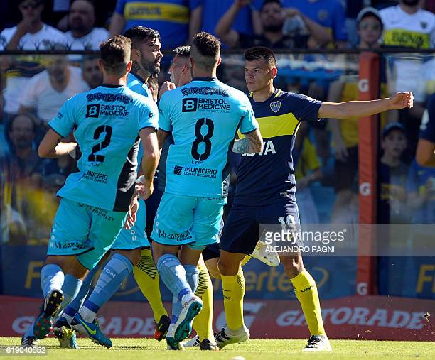 Temperley's defender Gaston Aguirre argues with Boca Juniors' forward Ricardo Centurion during their Argentina First Division football match at La...