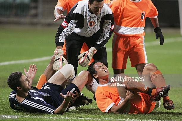 Tempers boil over after a tackle by Riki van Steeden of Auckland City FC on injured Raimana Li Fung Kuee of AS Pirae during the OFC Club Championship...
