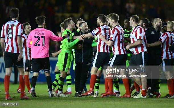 Tempers boil over at the end of the game as Forest Green Rovers' assistant manager Scott Lindsey centre stands between Forest Green Rovers' Scott...