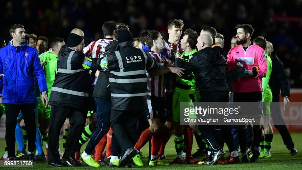 Tempers boil over between the Lincoln City and Forest Green Rovers players at the end of the game as Lincoln City manager Danny Cowley steps in...
