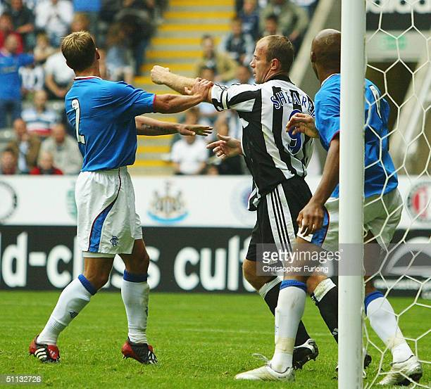 Tempers flair between Alan Shearer of Newcastle and Fernando Ricksen of Rangers during the Newcastle Gateshead Cup match between Newcastle United and...