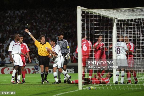 Tempers flair in the goal net between USA's Earnie Stewart and Iran's Mohammad Khakpour as the Referee Urs Meier awards the goal for the USA Eddie...