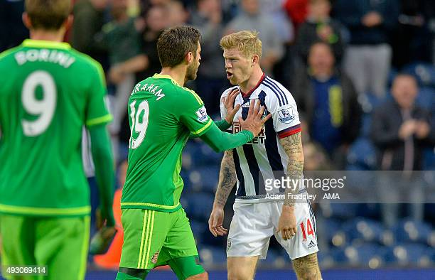Tempers flare after the final whistle as Danny Graham of Sunderland and James McClean of West Bromwich Albion have a go at each other after the...