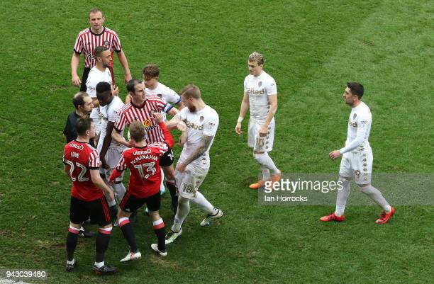 tempers flare as Gaetano Berardi of Leeds is sent off after a foul on Callum Macmanaman of Sunderland during the Sky Bet Championship match between...