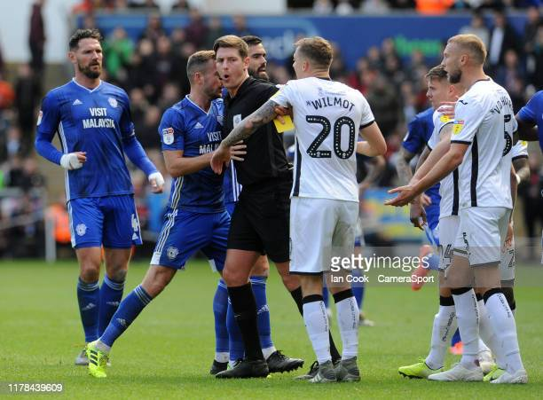 Tempers flare as referee Robert Jones separates the players during the Sky Bet Championship match between Swansea City and Cardiff City at Liberty...