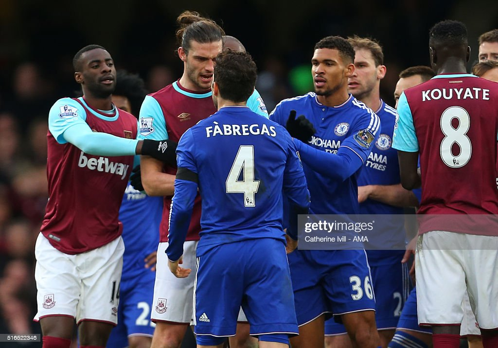 Tempers flare between Andy Carroll of West Ham United and Cesc Fabregas of Chelsea during the Barclays Premier League match between Chelsea and West Ham United at Stamford Bridge on March 19, 2016 in London, England.