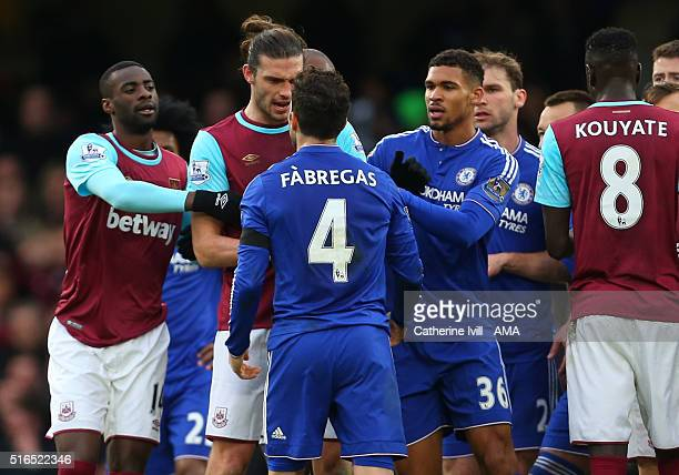 Tempers flare between Andy Carroll of West Ham United and Cesc Fabregas of Chelsea during the Barclays Premier League match between Chelsea and West...