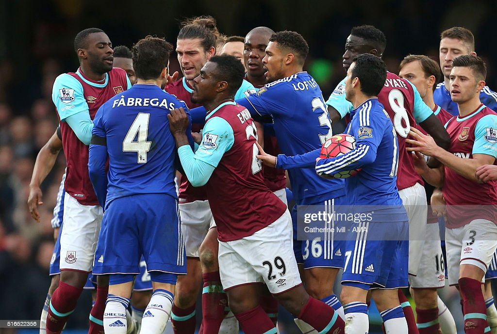 Tempers flare between Andy Carroll of West Ham United and Cesc Fabregas of Chelsea as their team mates also get involved during the Barclays Premier League match between Chelsea and West Ham United at Stamford Bridge on March 19, 2016 in London, England.