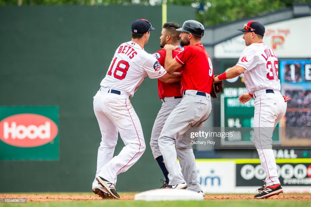 Tempers flare between Eduard Pinto #1 of the New Hampshire Fisher Cats and Matthew Kent #21 of the Portland Sea Dogs in a game between the Portland Sea Dogs and the New Hampshire Fisher Cats at Hadlock Field on July 15, 2018 in Portland, Maine.